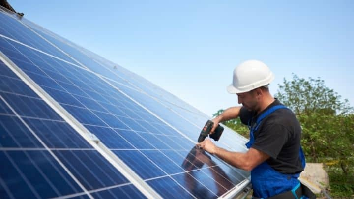Drilling solar panels on a roof - Close-up