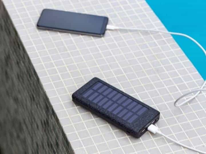 Solar Panel Charging a Phone by the Pool