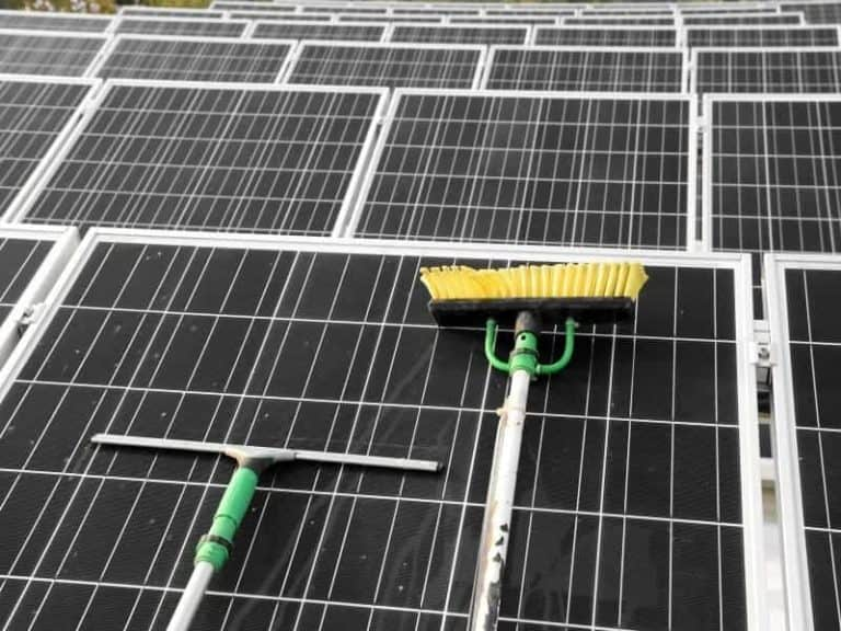 Cleaning Solar Panels With Brush and Squeegee